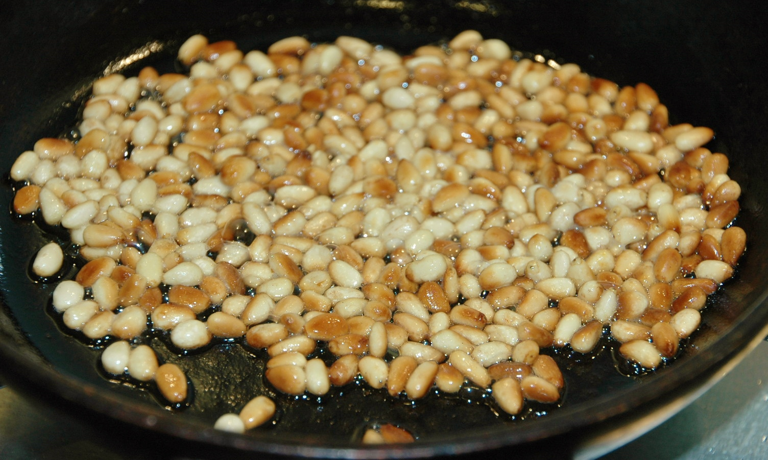 toasting the pinenuts in 1 teaspoon of garlic infused oil