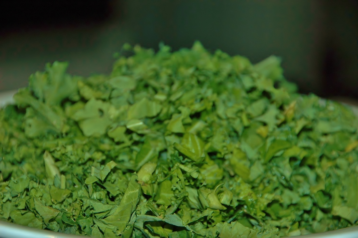 Finely chopped kale leaves awaiting their amazing dressing!